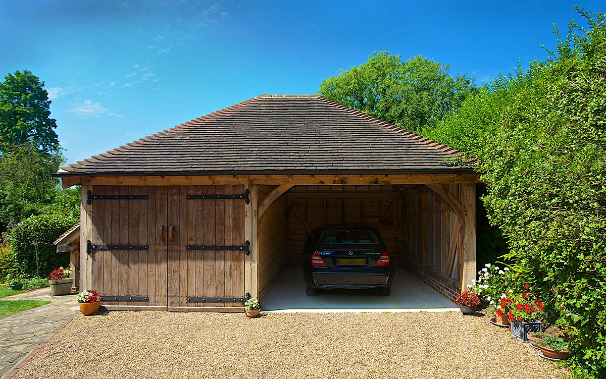 This two-bay cart barn garage features two different sized bays. The bay on the left is a standard size, and the bay on the right is SuperSize.